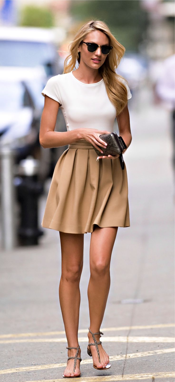 Candice swanepoel style. Ray ban , classic camel skirt