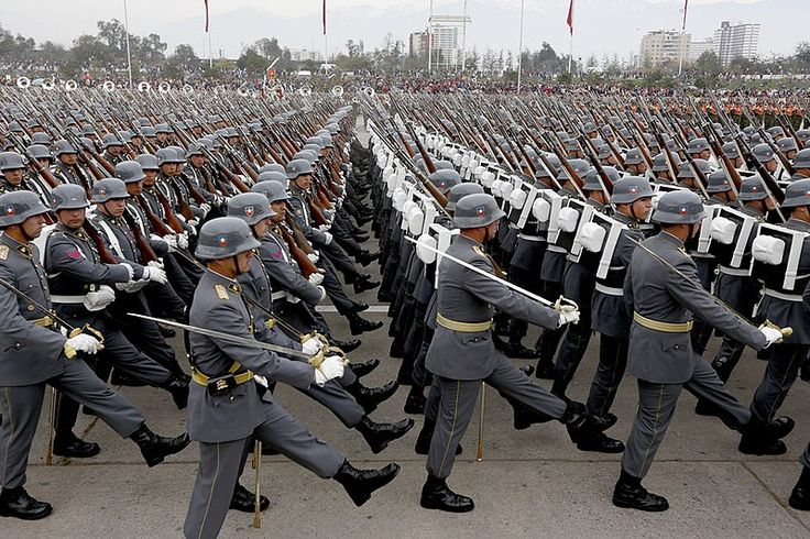 Cadets of the Chilean Army Non-Commissioned Officers' School (Escuela de Suboficiales del Sargento 2° Daniel Rebolledo Sepúlveda) marching through O'Higgins Park in Santiago at the 2015 Chilean Army Day Parade.