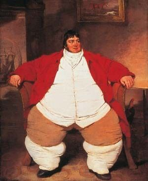"""Daniel Lambert, was a hunter, horseman, and jailkeeper in Leicester England who weighed 53 stone (742 pounds) by his mid-30s. Having fallen on hard financial times in 1806 he moved to London and displayed himself as a """"natural curiosity"""" to make money. He died at the age of 39 and the legend goes that it took 20 men more than 30 minutes to drag his coffin into the grave."""