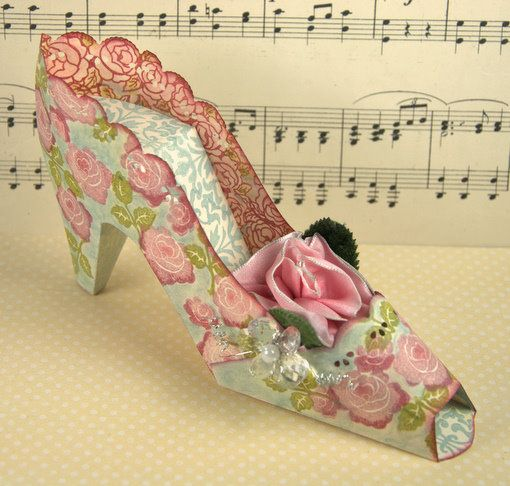 Paper Shoe@Jessica Simmons. What about these as favors? In ice blue with swirly details instead of flowers? I have made these before