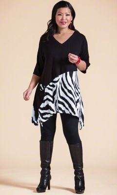 LEE TUNIC Take a walk on the wild side with the striking zebra print of our Lee Tunic. Pair with black leggings and boots; 3/4 sleeves, V-neckline, Curved hemline, 92% rayon/8% spandex, Machine wash. Comes in plus sizes