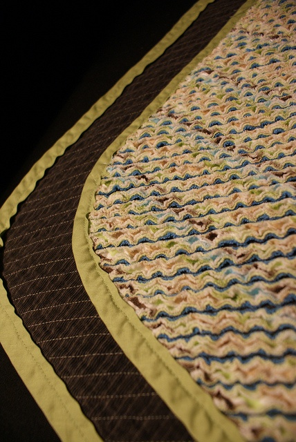 grey corduroy for the backing and three layers of recycled flannel receiving blankets for the cut chenille