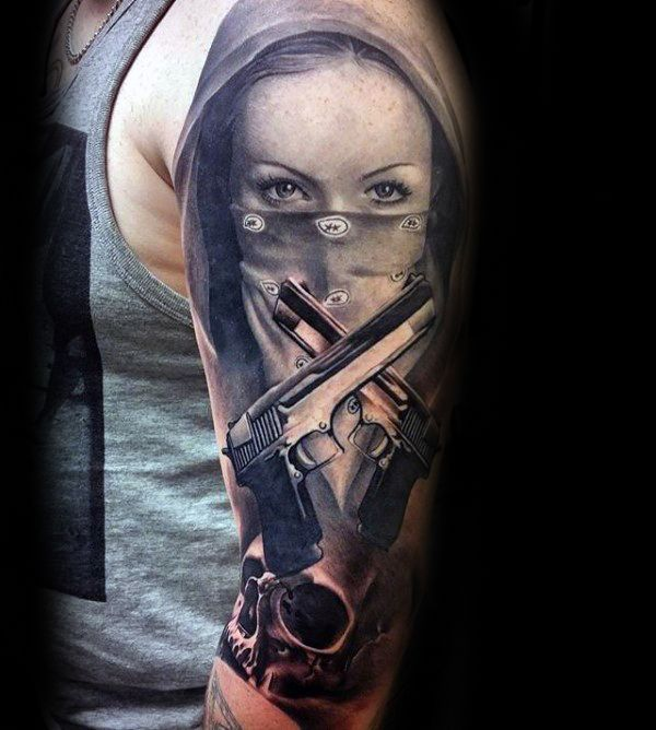 Im not feeling this tat...the guns don't look realistic and she just doesn't look gangster at all. All wrong!