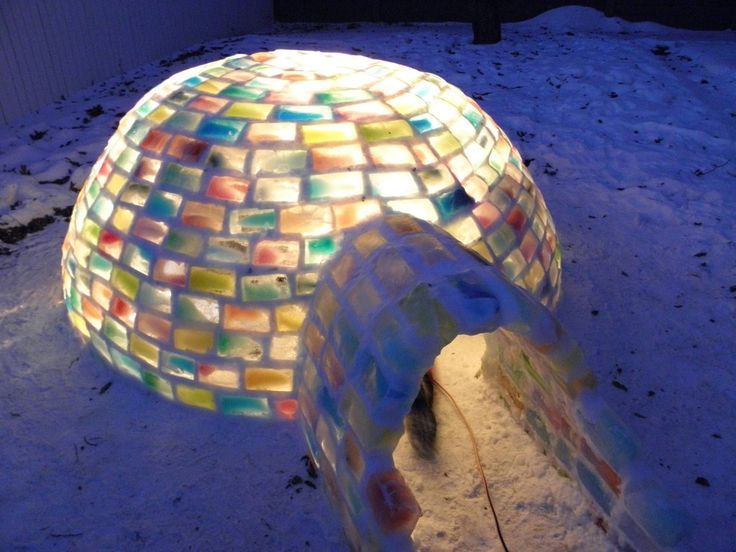 frozen milk cartons make bricks of colored frozen water to build an igloo in Edmonton, Canada