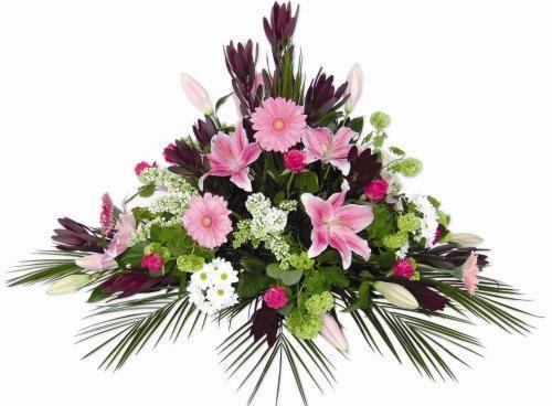 Entrega de centro funerario formado por gerberas claveles y lilium. Realizamos entregas de centros de flores para funerales urgente en toda España