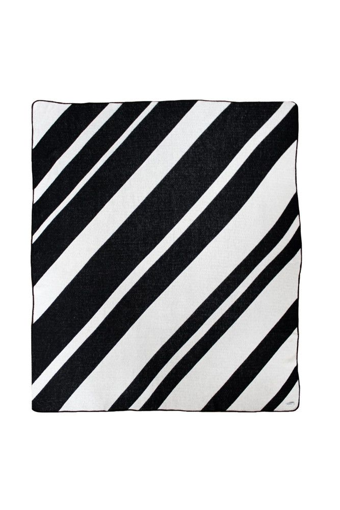 "<div><span style=""font-family: Calibri; font-size: 110%;"">Black & white stripes are always a classic. This knit throw blanket is an easy staple for your home. These diagonal stripes are always going in the right direction.</span></div><div><br></div><div><span style=""font-family: Calibri; font-size: 110%;"">100% Cotton. Machine wash cold, tumble dry low.</span></div>..."