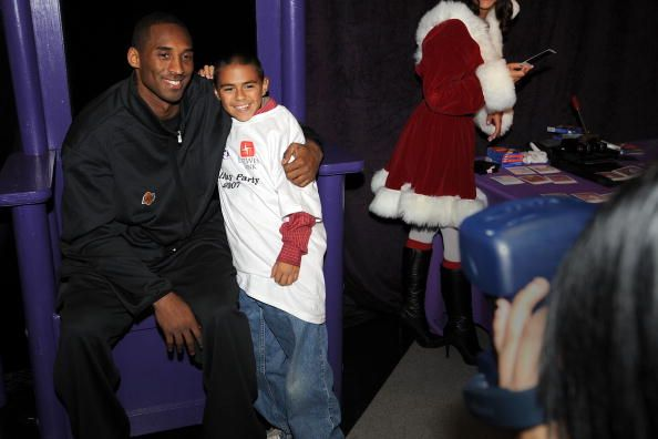 LOS ANGELES, CA - DECEMBER 15: Kobe Bryant of the Los Angeles Lakers poses for a picture during the teams 'A Season of Giving' annual holiday party for underprivileged children at the Toyota Sports Center on December 15, 2007 in Los Angeles, California.  Credit: Noah Graham / Contributor