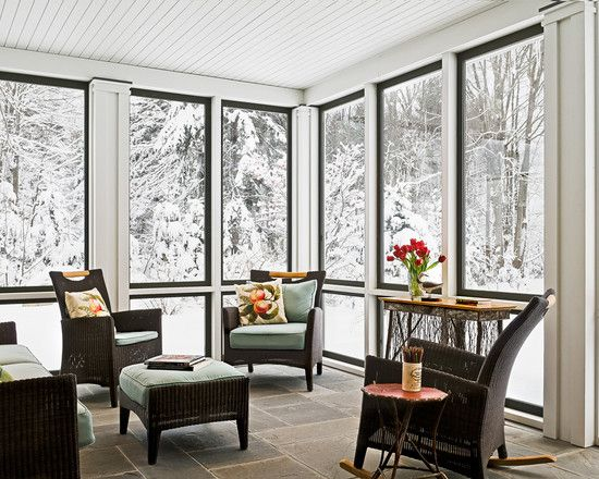 Beautiful snowy #landscape outside of an inviting #sunroom.  Wouldn't mind sipping some tea on that lovely #porch!