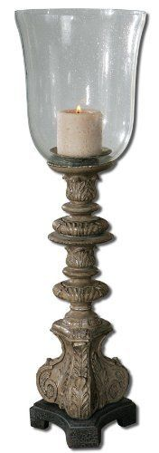 Uttermost 19720 NERIO, CANDLEHOLDER by Uttermost. $140.80. Length 7. Gold And Black Undertones. Black Crackle Base And Clear Seeded Glass Globe. Distressed Beige Candle Included.. Heavily Distressed Rust Gray Wash With Silver. Width 7. Height 27.5. Heavily distressed rust gray wash with silver, gold and black undertones. Black crackled base and clear seeded glass globe. Distressed beige candle included.Designer Carolyn Kinder. Save 26% Off!