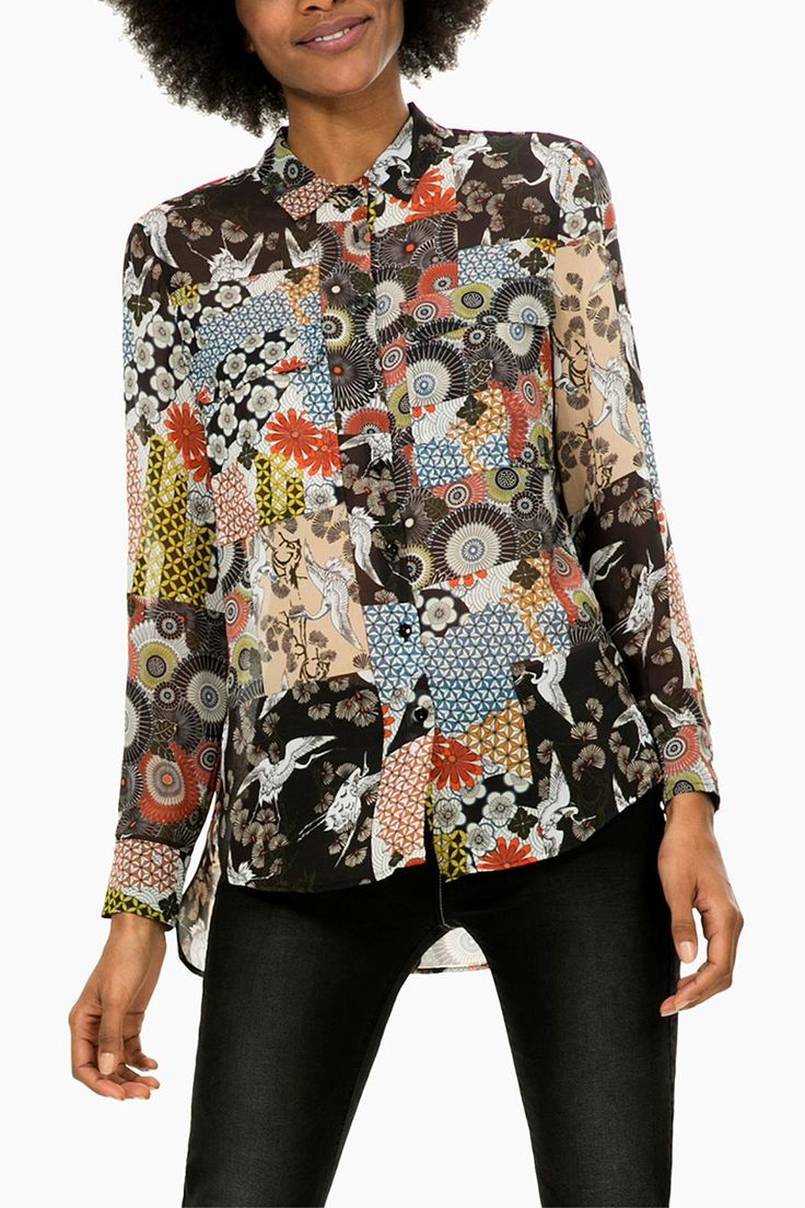 "This sheer tunic in a beautiful Asian-inspired print features a button front, double chest flap pockets, and a longer shirttail back. Wear with a black tank and leggings or tuck into pants and skirts for the work day. Please note that American sizing is one size smaller than the European size.    The European small measures 24"" from the neck to the hem in front, 29"" in the back, 19"" across the bust, and the sleeves are 22.5"" from the shoulder.   Asian Print Tunic by DESIGUAL. Clothing - Tops…"