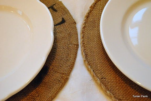 Burlap chargers - two designs. One with braided twine edging, other with burlap wrapped around donut shape cardboard.