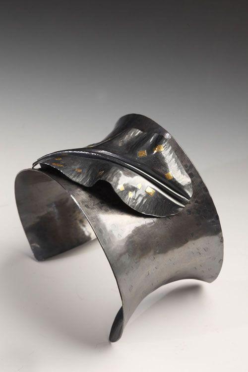 Cuff   Lona Northener.  Sterling silver, 24k gold, oxidized.