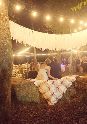 Quilts thrown across the hay bales in this country wedding. ... paper lily photography, atlanta.