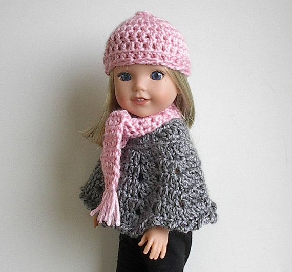14.5 Doll Gray Crocheted Poncho w/ Light Pink Hat and Scarf Set Handmade to fit Wellie Wishers and other similar 14 dolls - Ready to Ship  Made using quality 100% acrylic soft yarn, this set consists of crocheted poncho, hat and scarf. The poncho is a soft charcoal gray, and the hat and scarf are a light pink. You may also select white hat and scarf, or black hat and scarf, if you prefer. The poncho slips on easily over the head. The hat is topped with a crocheted bud, and there is fringe on…
