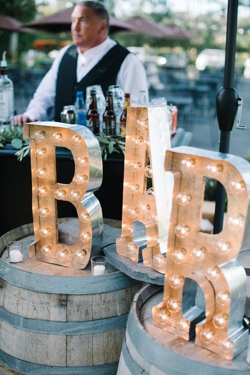 Elegantly rustic outdoor wedding reception bar; Featured Photographer: John Schnack Photography, Featured Event Design: Très Chic Affairs