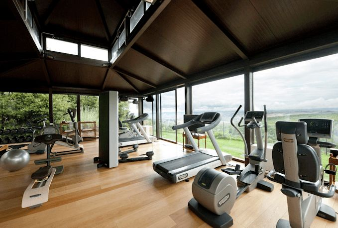 The World S Most Luxurious Hotel Gyms Well Good Home Gym Flooring Dream Home Gym Luxury Gym