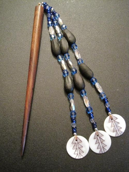 Hair stick, David Two Sticks Arwood II (Karuk) David is teaching his daughter Aurora how to make traditional Karuk jewelry; the proceeds from the pieces they sell will be used to help finance Aurora's coming of age ceremony, the Flower Dance. As part of the ceremony Aurora will make a traditional bark skirt and buckskin dress which will become part of her regalia collection.