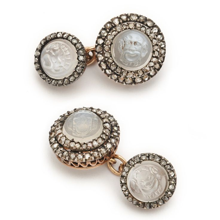 Victorian Carved Moonstone Double Cufflinks. Carved mask moonstone double cufflinks with rose-cut diamond surrounds, mounted in rose gold. English, ca. 1870.