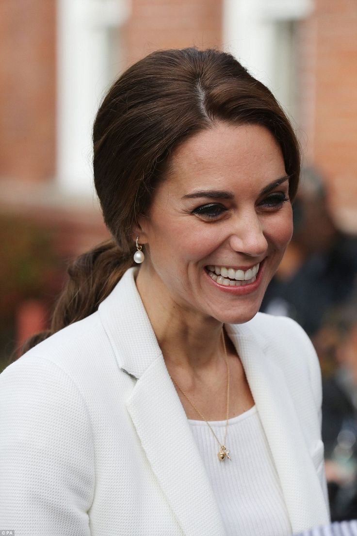 The Duchess beamed as she arrived in Victoria, Canada, looking as chic as ever in a crisp white outfit and minimalist jewellery