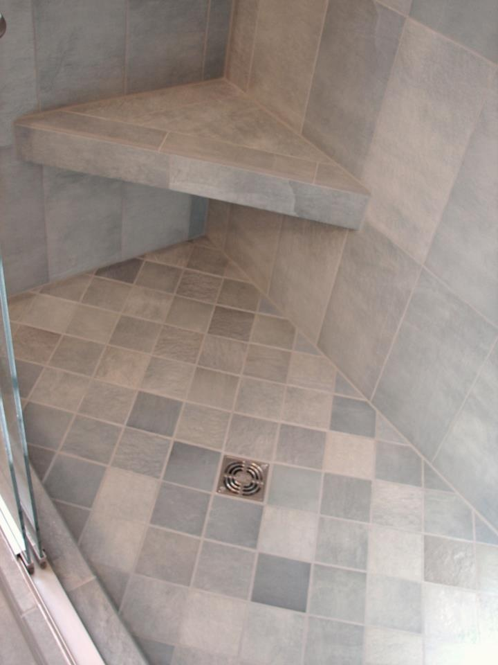 corner bench walk in mortar tiled shower pan