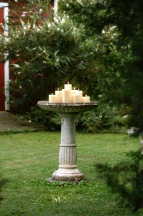 Bird bath styled with candles for an outdoor party..... So doing this with our two bird bathes!!!