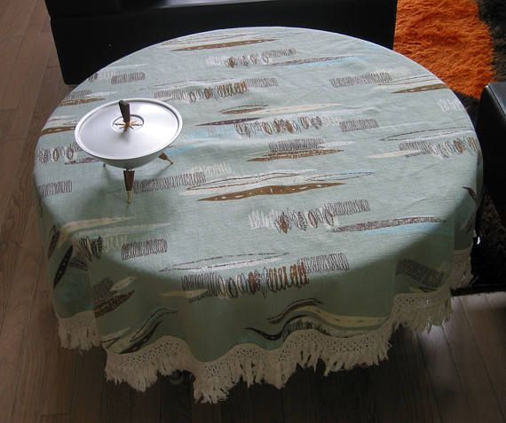 Vintage Barkcloth Tablecloth (or Fabric reuse)  Atomic design on sea foam green background Size: Round, 41 x 44 inches plus white fringe  Condition: No holes or rips. Stain on fringe (see photo), did not try and wash out. Questions? Please ask. Thanks for looking.  (Note: Sale is for one tablecloth, not accessories.)