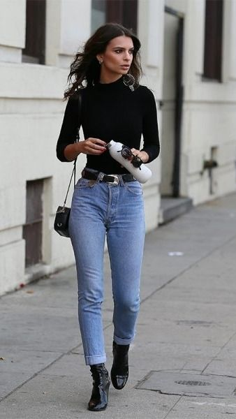 We've rounded up all of Emily Ratajkowski's best looks... we're especially loving this chic spring ensemble of vintage jeans, western belt, patent leather ankle boots, and a black turtle neck.