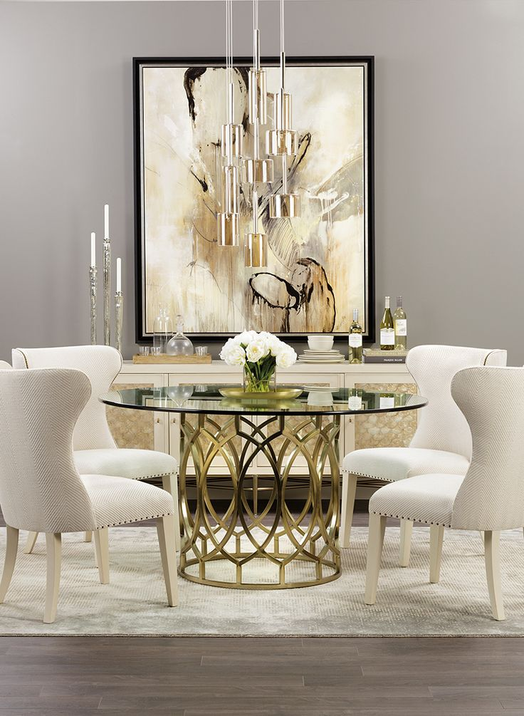 Modern Glamour: Soft, timeless colors get a contemporary spin in this radiant dining room. The buffet's shimmery shell inlay catches the light from the modern glass pendants. The table's metal lattice base lets the room feel airy, while dramatic wing back chairs keep it grounded. $1,679.00: