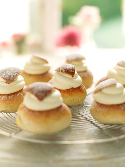 Classic Swedish Semlor, filled with a almond paste and whipped cream!