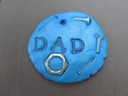 Make this cool clay keychain and stick little things like screws and nails into it for your dad!