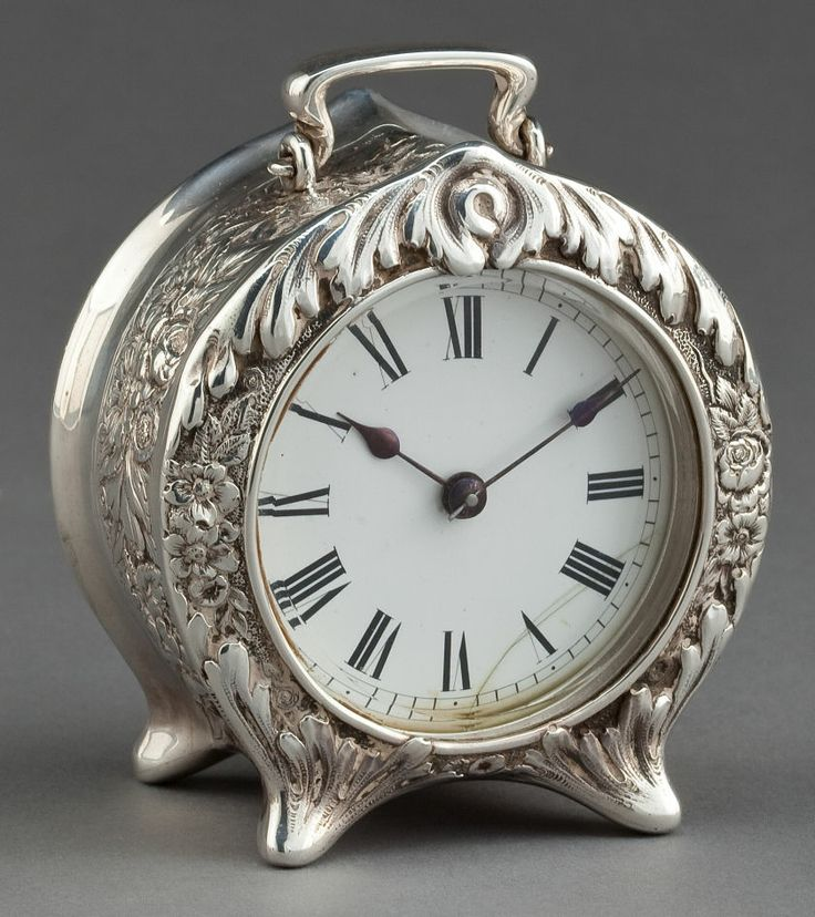 Vintage sterling silver carriage clock on four feet with repoussé decorations by Tiffany  Co. NewYork, c. 1887