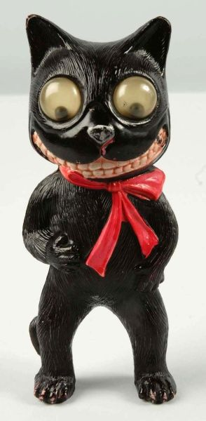 "Celluloid Halloween Black Cat with Googly Eyes.  Description Possibly a rattle. Condition (Excellent). Size 5 - 3/4"" T."