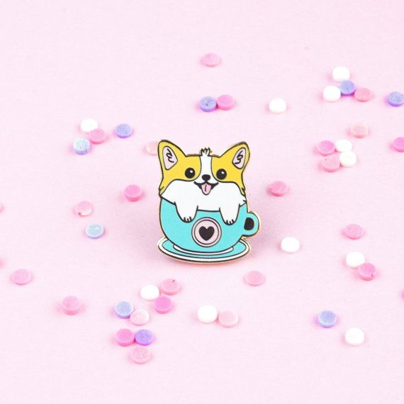 Its a cute fluffy corgi inside a coffee mug! Get yourself this pin so you can carry your own corgi in a mug with you everywhere :) - Hard Enamel with one rubber black pin back - Measures approximately 1 inch in height - Gold metal outline and detailing Please note that there may be slight color differences between the product picture and the real product due to the different resolutions and graphic settings on our computers. Thank you for understanding