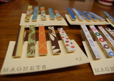 cover clothes pins with scrapbook paper, add a magnet to the back, and you have a great gift or something wonderful for your white board.