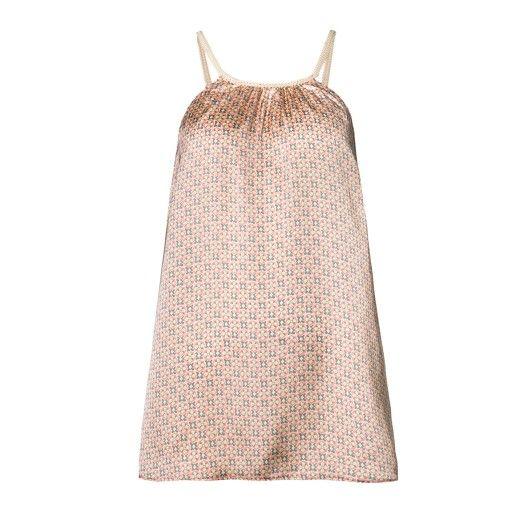 Top lungo, in tessuto stampato, scollo a U lavorato e con colore a contrasto, scampanato sul fondo. Vestibilit� morbida.