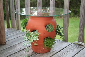 "Strawberry Pot Table.  I got the 4 ""slot"" version at Home Depot today and planted strawberries, this might make a cool ""end table"" in the garden!"