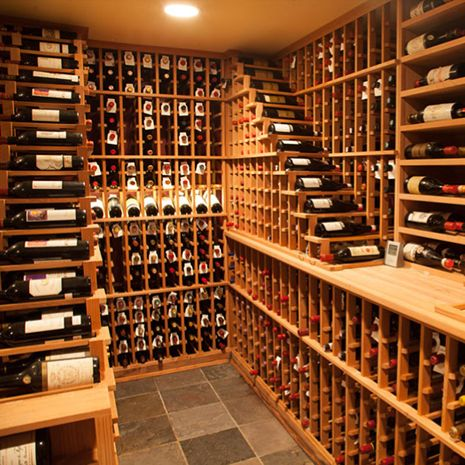 This 2000+ bottle custom wine cellar, designed by Wine Enthusiast Consultant David Moseler, was constructed in an underground space below a carriage house set aside from the customer's home.