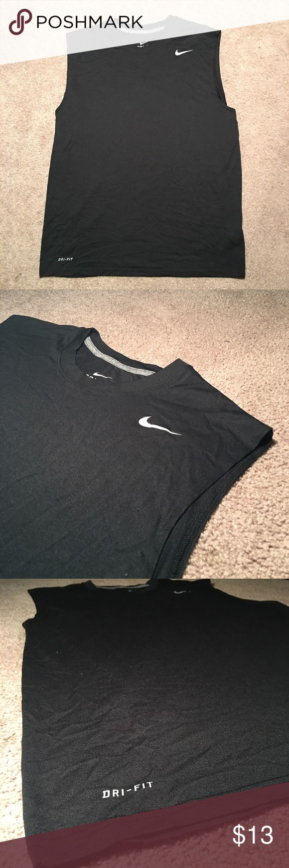 Men's Nike Dri Fit muscle shirt. Comfortable and I'm great condition. Nike Dri Fit. Awesome shirt to workout in. Nike Shirts Tank Tops