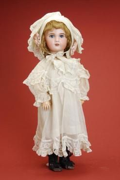 Bisque Doll; SFBJ, Child, Blue Sleep Eyes, Open Mouth with Teeth, 27 inch.