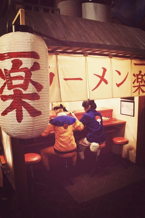 Naruto and Sasuke eating ramen. I wonder if they got it for free.... If I worked in a restaurant and someone came in in cosplay I would at least give them a discount