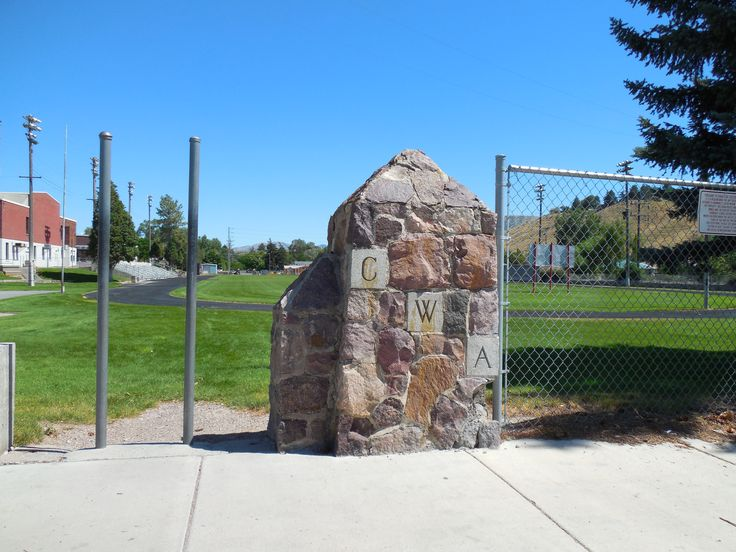 The CWA on that rock pillar stands for Civil Works Administration (built the outdoor stands for Irving Jr High, Pocatello ID)