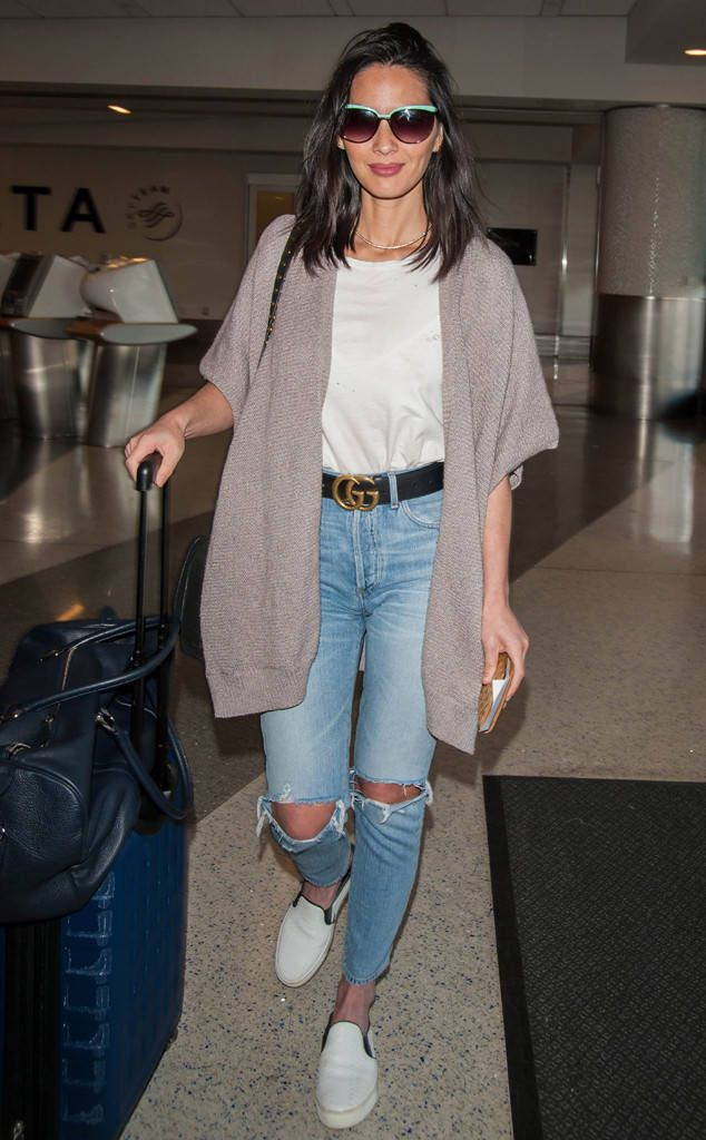 Olivia Munn from The Big Picture: Today's Hot Photos  Jetting off! The newly single actress is all smiles at LAX.