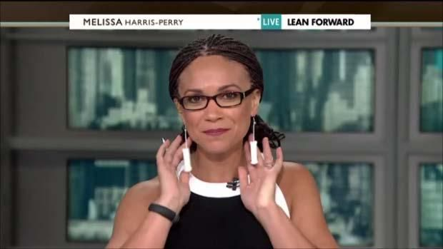 Melissa Harris Perry wearing tampon earrings while lamenting restrictions on murdering babies in Texas.