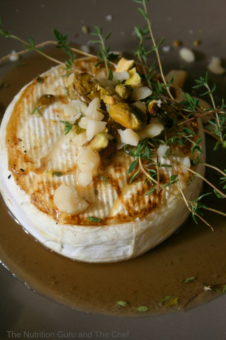 Grilled camembert cheese thyme infused honey pistachio and macadamia nuts