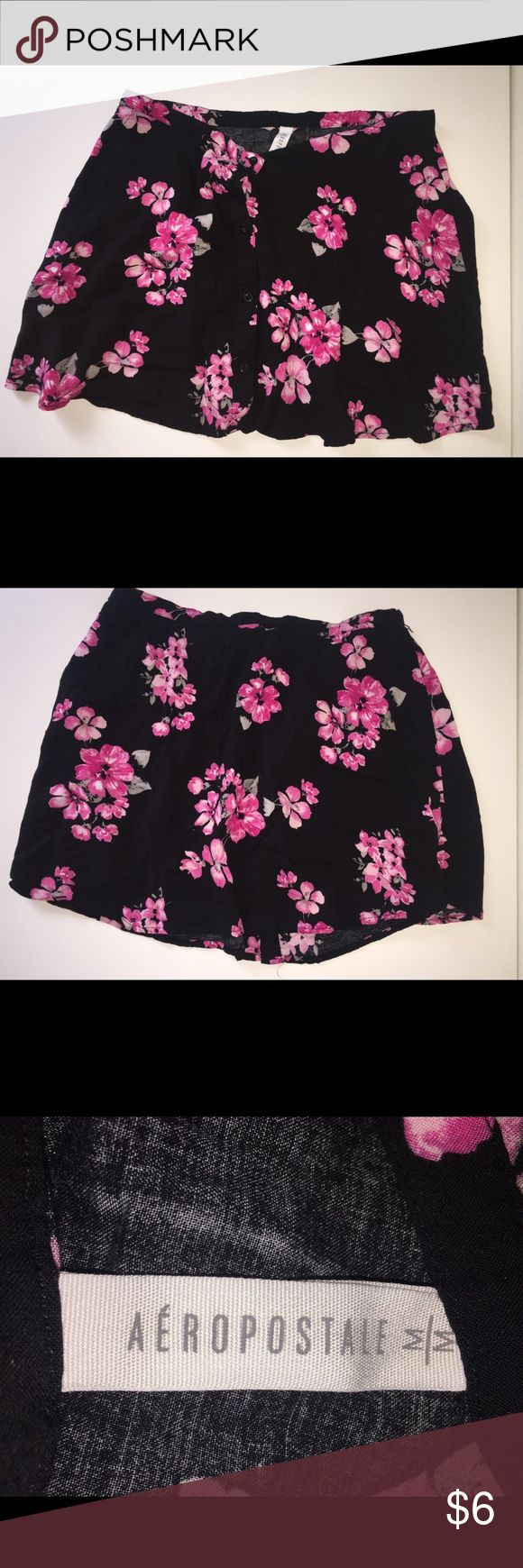 Aeropostale Mini-skirt! This is a super cute mini-skirt size M. It's really pretty but I guess it is too short for me now. It has bright and light pink flowers on a black background. I wore it  once at the beach, but that's it! Aeropostale Skirts Mini
