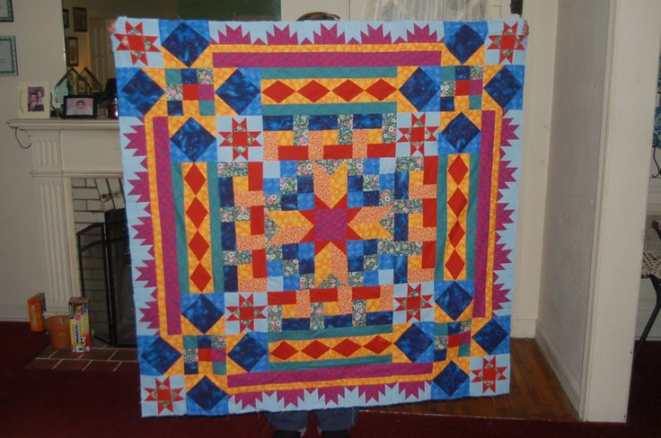AQS mystery quilt 2012. I made it from scraps as I followed along. So much fun doing it that way.
