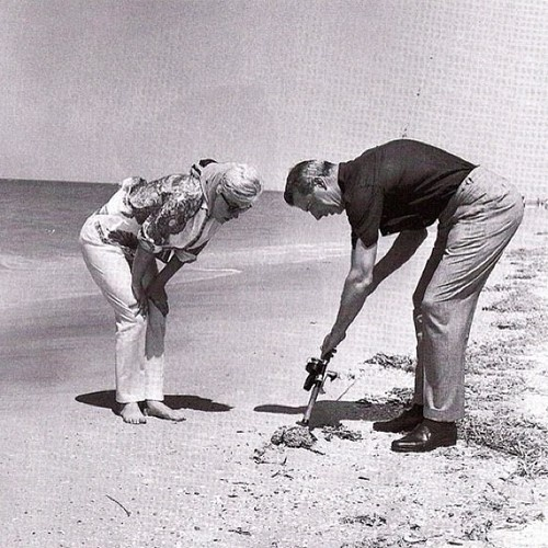 MarilynMonroe and Joe DiMaggio looking at a crab in Florida, March of 1961. (Taken with Instagram)