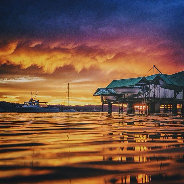 An atmospheric sunrise over Sandy Bay, an inner-city suburb of Hobart. Many of the suburb's residents have a love for sailing, and have their boats – an eclectic mix of modest and extravagant – moored at the nearby Royal Yacht Club of Tasmania. #discovertasmania #sailing #sandybay #sunrise #hobart #tasmania Image Credit: Matt Glastonbury