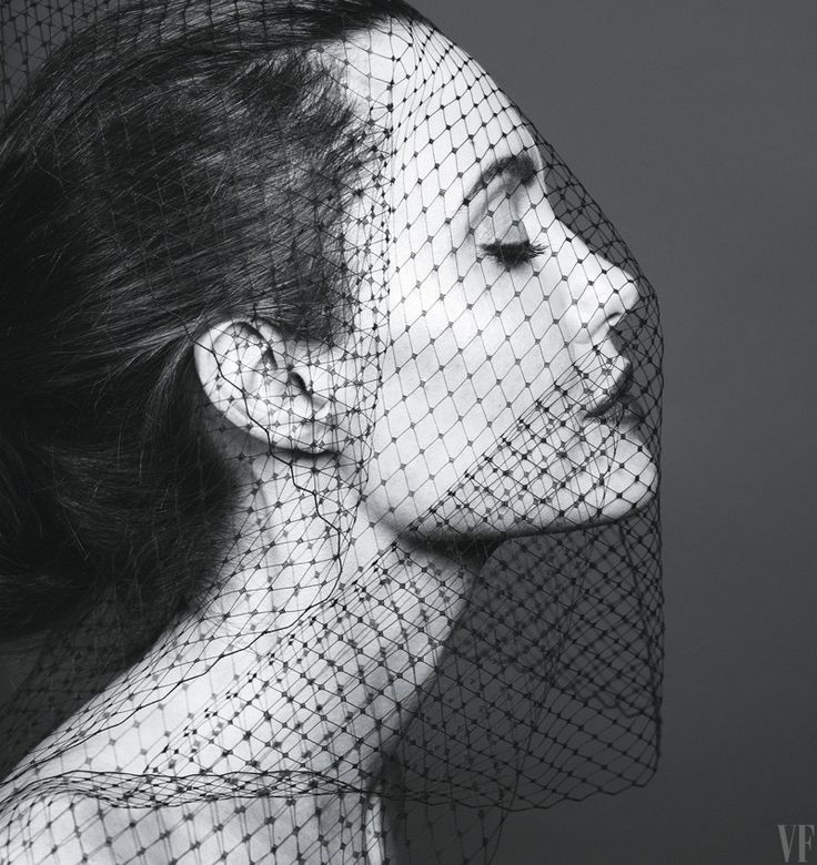 Getting her closeup, Angelina Jolie wears mesh veil
