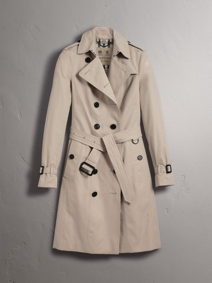 Our tailored-fit trench coat, the Sandringham is cut to contour the body for a streamlined look. The coat is made in England from weatherproof cotton gabardine, invented by Thomas Burberry in 1879. A classic for all seasons and occasions, the trench can be worn belted for a close fit or open and relaxed over dresses and denim.